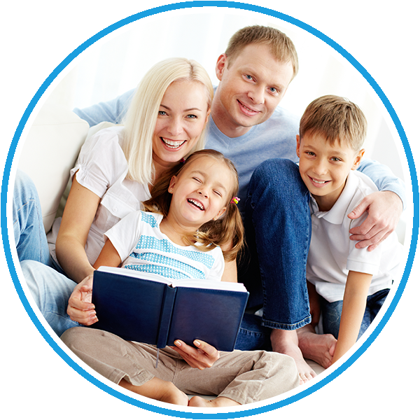 Happy family reading book | Dentist Preston